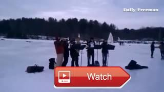 A brass band from Bard College performs a Beatles tune on the Hudson River ice while ice boats sail  A brass band from Bard College performs a Beatles tune on the Hudson River ice while ice boats sail by on March UID