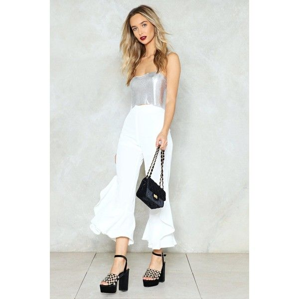 Nasty Gal Ride The Wave Ruffle Pants ($28) ❤ liked on Polyvore featuring pants, capris, white, white cropped trousers, white pants, white crop pants, zipper pants and ruffled trousers