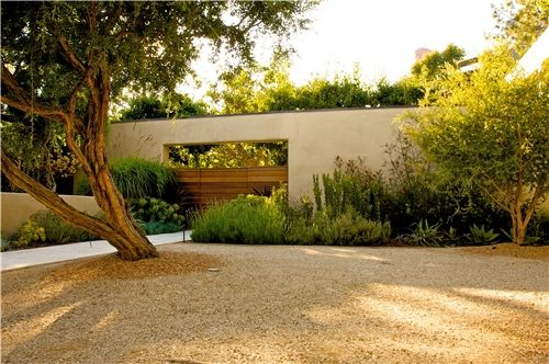 This front entry courtyard features decomposed granite and low-water use plants. Landscape by Fiore Design in North Hollywood, CA. Read more about how this Malibu property was transformed into a contemporary, waterwise space: http://www.landscapingnetwork.com/los-angeles/Malibu-drought-tolerant.html#