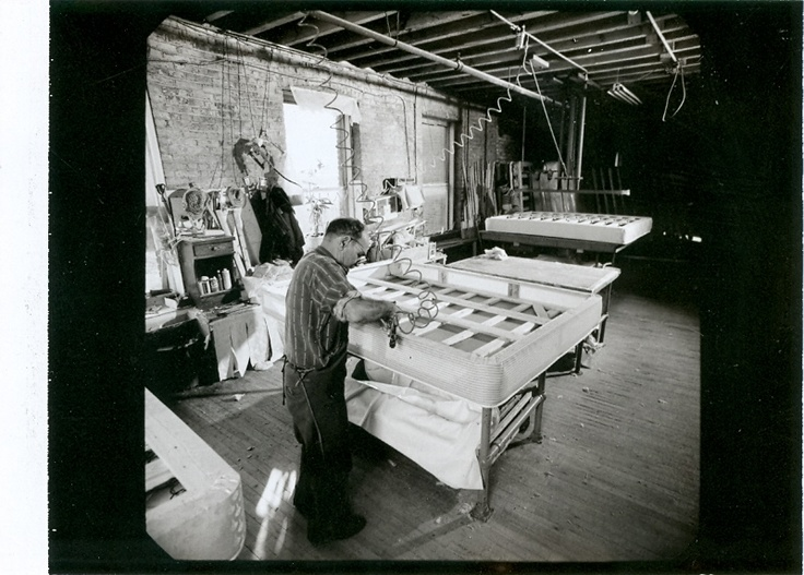 A Shifman Employee Lies Fabric To Boxspring Frame Us Historyfamily Historymattressesmattressamerican History