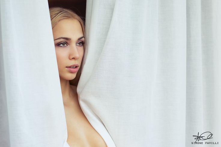 Photograph Caterina through curtains by Simone Favilli on 500px