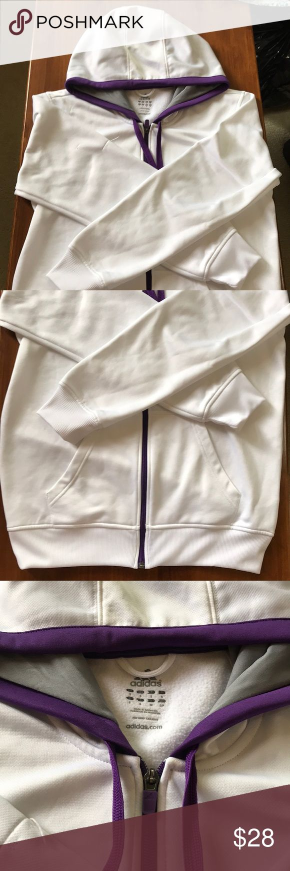White Adidas Zipped Up Hoodie White adidas zip up with hood. Has purple accents and fleece lining on the inside. Some piling and loose threading on the sleeve. Other wise in great used condition. adidas Shirts Sweatshirts & Hoodies