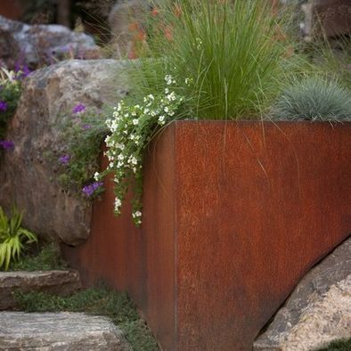gorgeous integration of corten steel with stone in an AguaFina Gardens International landscape design