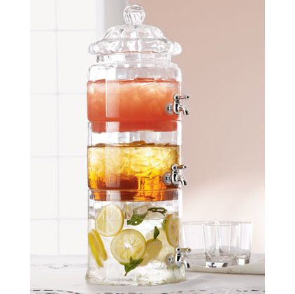 Glass beverage dispensers are stylish but normally take up a lot of table space when serving multiple beverages. This stacked server is perfect for solving the problem.