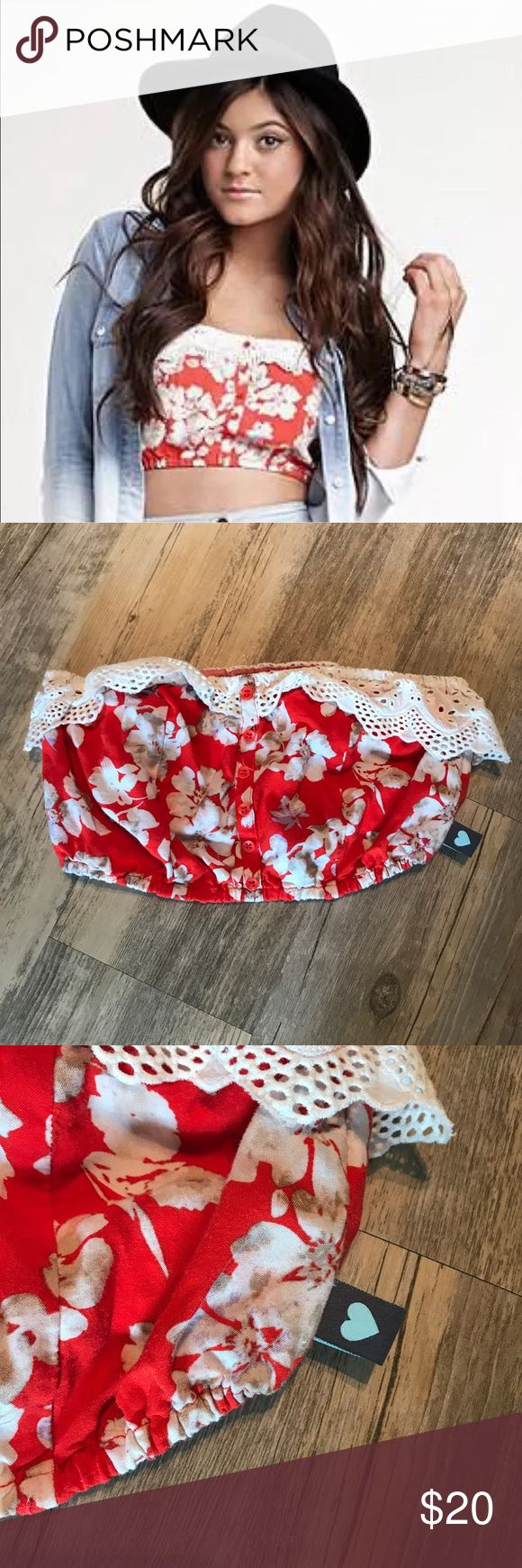 KENDALL & KYLIE sold out red floral Bandeau top Kendall & Kylie Collection Floral Eyelet Bandeau Red Crop Top Shirt SOLD OUT XS   Red with white floral pattern. Has eyelet trim on top and buttons running down the center. They are just decorative, the buttons do not actually open/close. Elastic on top and bottom.  Great condition.  Size XS Kendall & Kylie Tops Crop Tops