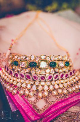 Indian Wedding Jewlery - Uneesh & Aashna wedding story | WedMeGood | Polki and Emerald and Ruby Choker with Pearl Hangings #wedmegood #indianjewelry #polki #choker #ruby #weddingjewelry #jewelry #indianweddingjewelry