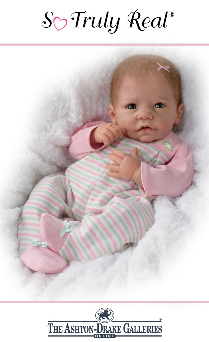 Weighted and poseable doll handcrafted of RealTouch® vinyl with hand-painted features, wispy strawberry-blonde hair.