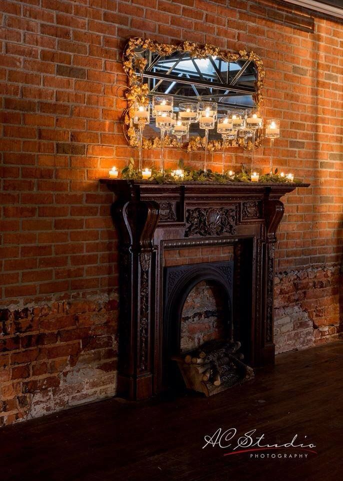 Roswell Historic Cottage - This is the fireplace which will be the back drop to the ceremony aisle where we say our vows. I would love to have the majority of it covered with flowers or garlands or something to draw attention from a fake fireplace against a brick wall.