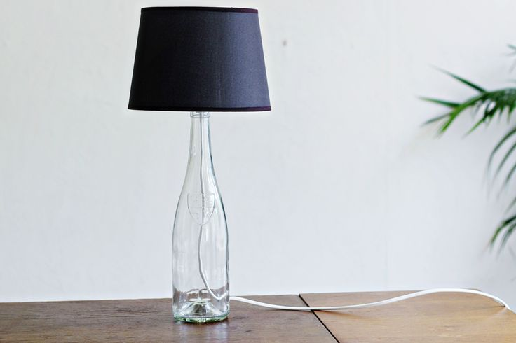 Check out this lamp made from old wine bottle. Don't throw your wine bottley away yet! Click on image to see more impressive DIY crafts.