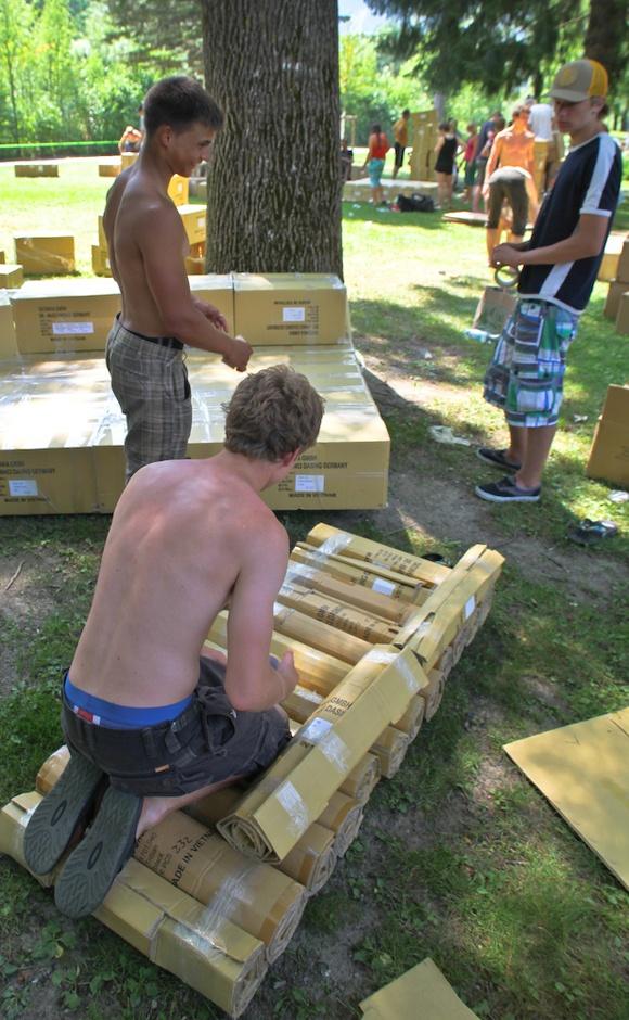 Carefully constructing their ship for the Teva Cardboard Race.