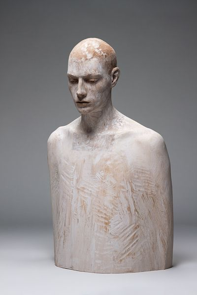 Bruno Walpoth, wood sculpture. the figure looks distant, I wonder what the meaning behind this is...