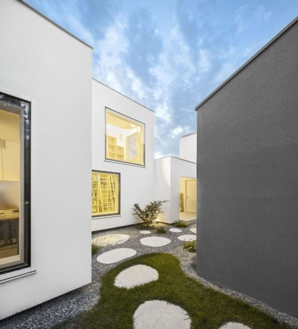 powerful green area space idea equipped with grey outdoor wall painting plan applied in haus von arx home exterior design