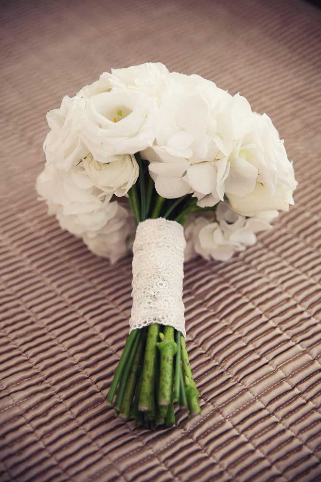 Pure white wedding bouquet with lace.- what are these flowers? Like the lace Our guess would be White Hydrangea and Lisianthus (Eustoma) ;)