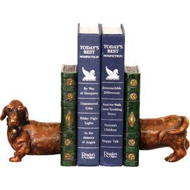 """Pair of bookends with a dachshund silhouette.   Product: 2-Piece bookend setConstruction Material: Composite woodColor: BrownDimensions: 6.25"""" H x 5"""" W x 4.25"""" D each"""