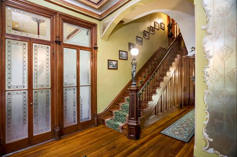 Staircase and frosted glass doors of The Armour-Stiner Octagon House, Irvington-On-Hudson, New York