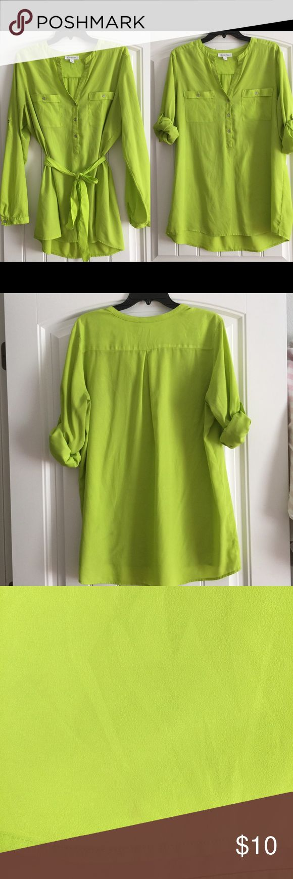 Neon lime green shirt Has a utility sleeves and belt but no belt loops making it easy to wear without the belt. Has some spots. Will possibly come out haven't tried. Noticed them as I was taking pics. This was never in the dryer so the stains haven't set. Calvin Klein Tops