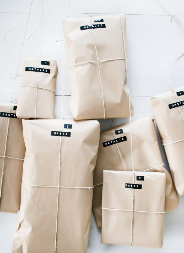 simple gift wrapping with kraft paper, twine and tags printed with a labeler