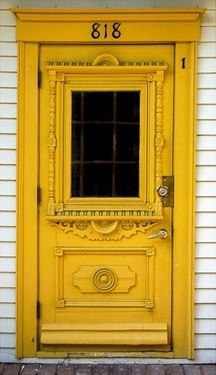 Detailed yellow door in Mont-Tremblant, Quebec, Canada.