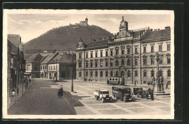 old postcard: AK Brüx / Most, Adolf Hitler-Platz mit Geschäften, Straßenbahn, Pferdekutsche