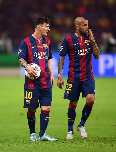 Lionel Messi and Daniel Alves of Barcelona talk during the UEFA Champions League Final between Juventus and FC Barcelona at Olympiastadion on June 6, 2015 in Berlin, Germany.