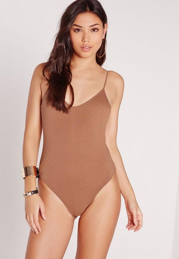 Strap in and make sure you're on top of your fashion game. Opt for this bodysuit to take you from day to night. Featuring cami straps and an on trend camel hue, you'll be looking tip-top. Style with skinnies, a bomber jacket and barely ther...