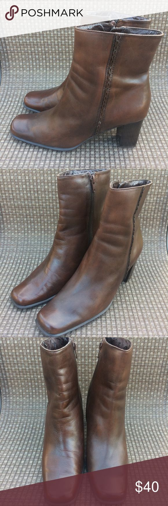 🌺🌺St. John's Bay Booties Pre-owned St. John's Bay brown booties. They are made of genuine leather upper and manmade lining. See photos for imperfections. Creases present in leather, inner manmade lining is stripping and very minimal scratches. Overall, the boots are in good condition. ASKING PRICE OR BEST OFFER! St. John's Bay Shoes Ankle Boots & Booties
