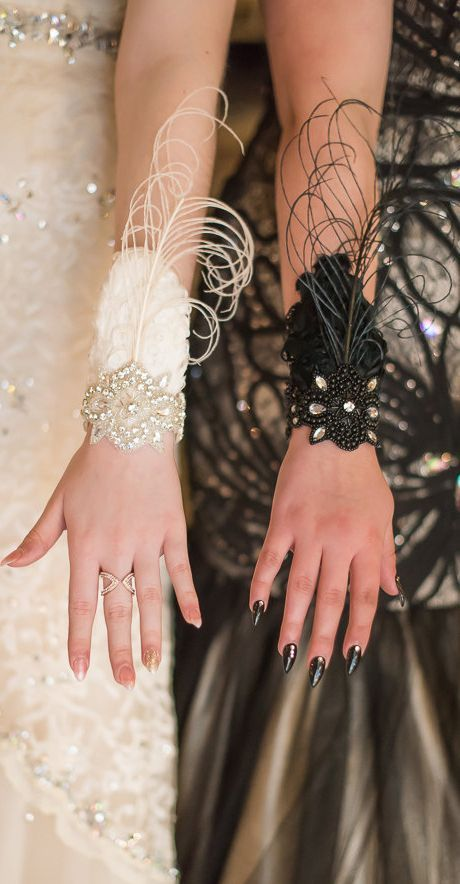 1920s Gatsby style Party or Bridal wrist corsage, perfect for prom, winter events, masquerade balls or weddings features a triangular swathe of vertical curled white feathers with one lighter white feather overlaid and an ecru-taupe curled feather sprig. #gatsbyparty #roaring20s #downtonabbey #gatsbystyle #newyearseve #wristcorsage #flapperdress #sequindress #vintagetheme #christmas #affiliatelink #partywear #flappers