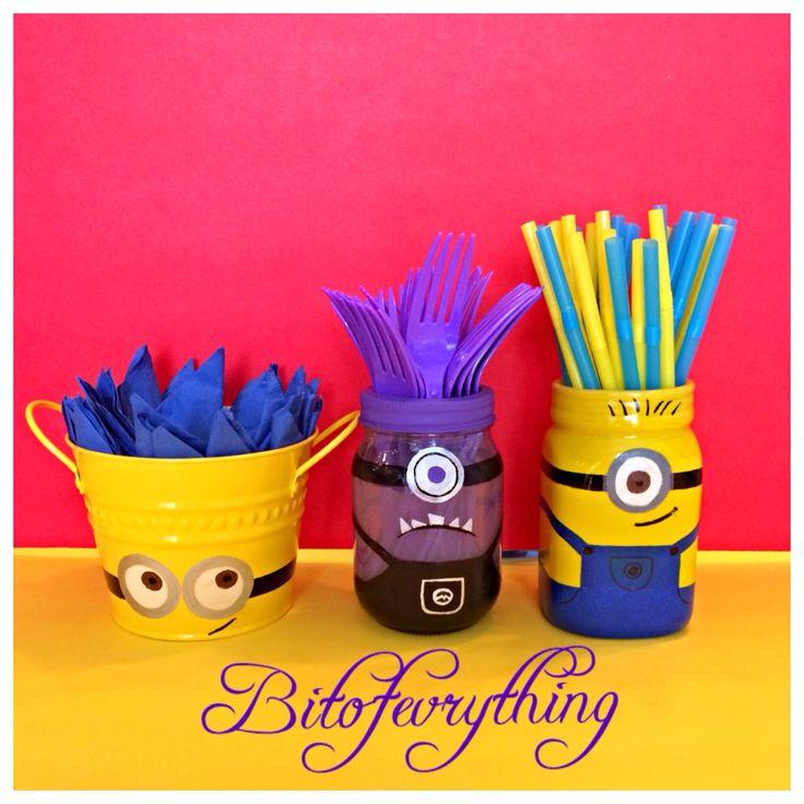 Minion birthday party. I painted Mason jars & a bucket with enamel paint & put napkins, forks & straws inside