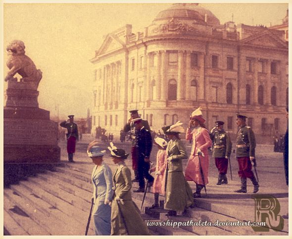 1912 - Tsarina Alexandra chats with her eldest daughter, Olga, while the Tsar and other three daughters trailed them. Petrovskaya Embankment in St. Petersburg, Russia