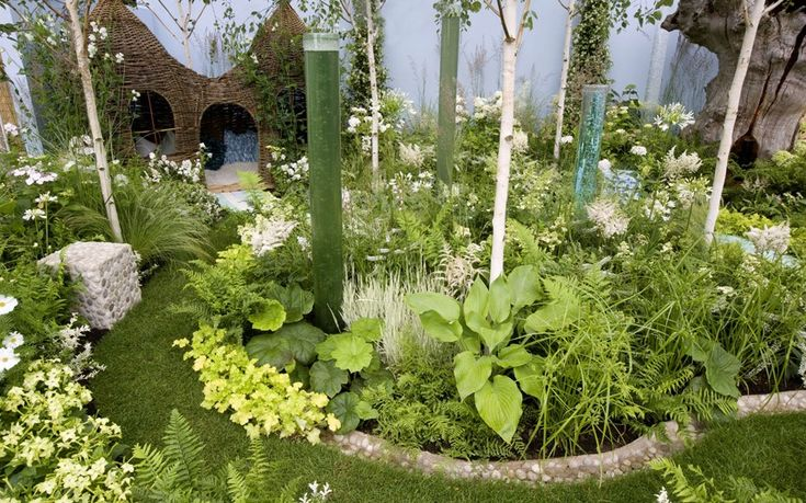 Hampton Court Flower Show 2012  Corner Of The World  Exhibitor: Nick Buss & Clare Olof  Sponsors: Oaktree Garden Centre & World Of Water, Apollo Creative, Judith Needham Willow Work  The garden is primarily designed for use by autistic children, to be an escape from the outside world.  Picture: MARTIN POPE