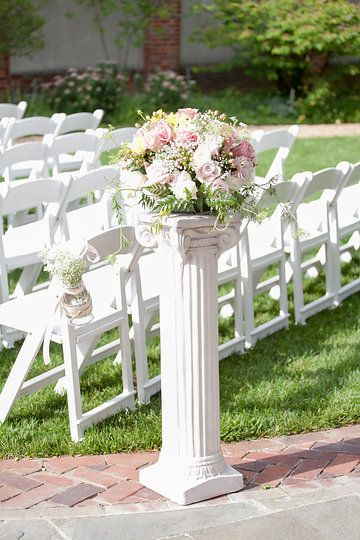 Aisle flowers pink and ivory roses
