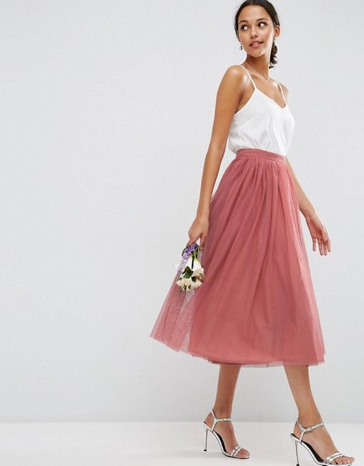 Pink tea-length, high-waisted skirt