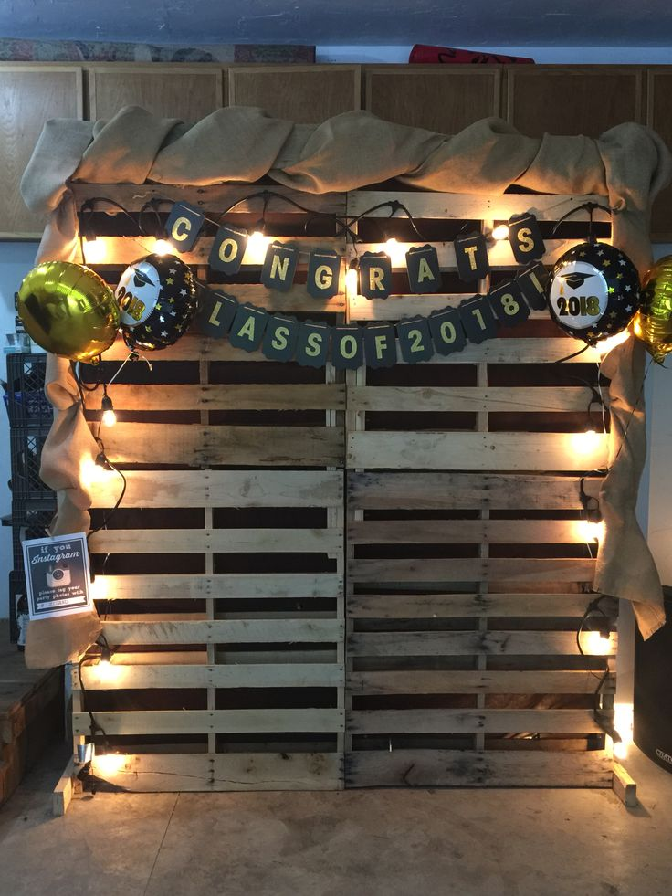 Graduation party photo booth back drop. The rain forced us into the garage, but …
