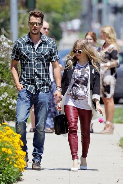 Pregnant Fergie celebrates her first Mothers Day as an expectant mom by going to church with husband Josh Duhamel in Beverly Hills. The  38 year-old Black Eyed Peas singer rocked leather pants as she walked out of church holding hands with her actor hubby.