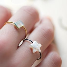 Full tutorial on how to make cute filigree wire rings with pearl beads!