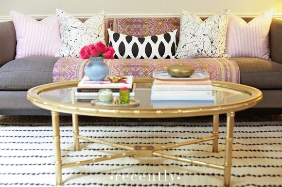 gold spray paint, a bamboo table, and furbish pillows