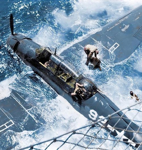 Take a moment and look at all the elements of this photo. It's obvious the crew had to abort, the turret gunner is climbing out, the pilot is inflating the raft, it appears there is a another person just aft of the starboard wing and the netting is obviously from a ship along side.