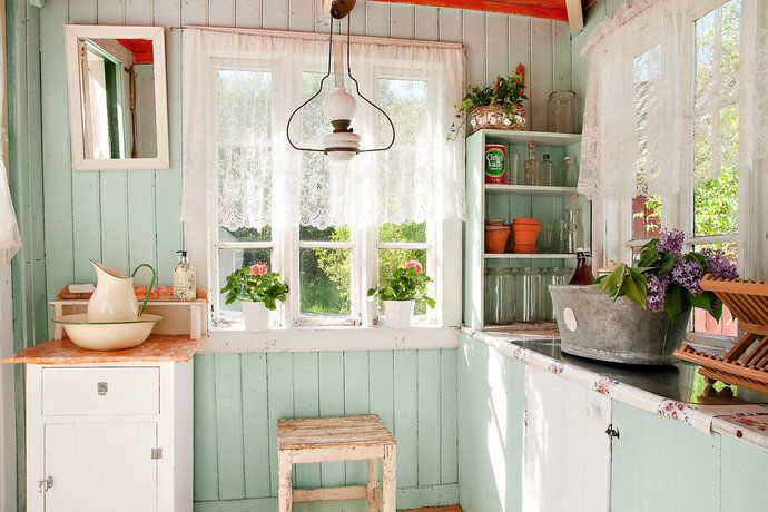 Love the green kitchen! Kitchen / dining area in a Swedish stuga built in 1791.