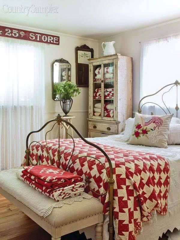 Great Red quilt helps accent the vintage rust on this old iron bed.
