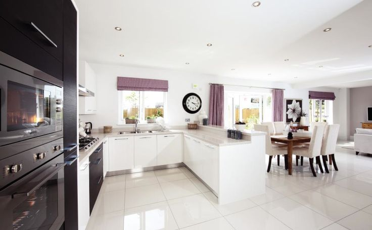 Ultra modern kitchen, breaking up the black and white gloss with accents of aubergine. Lovely kitchen dining room idea from Redrow Homes (Pershore) 2014