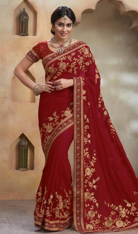 Look trendier than your friends in this maroon color embroidered georgette sari. The lace and resham work seems to be chic and perfect for any function. #reshamworksaris #marooncolorsari #attractivelooksaree