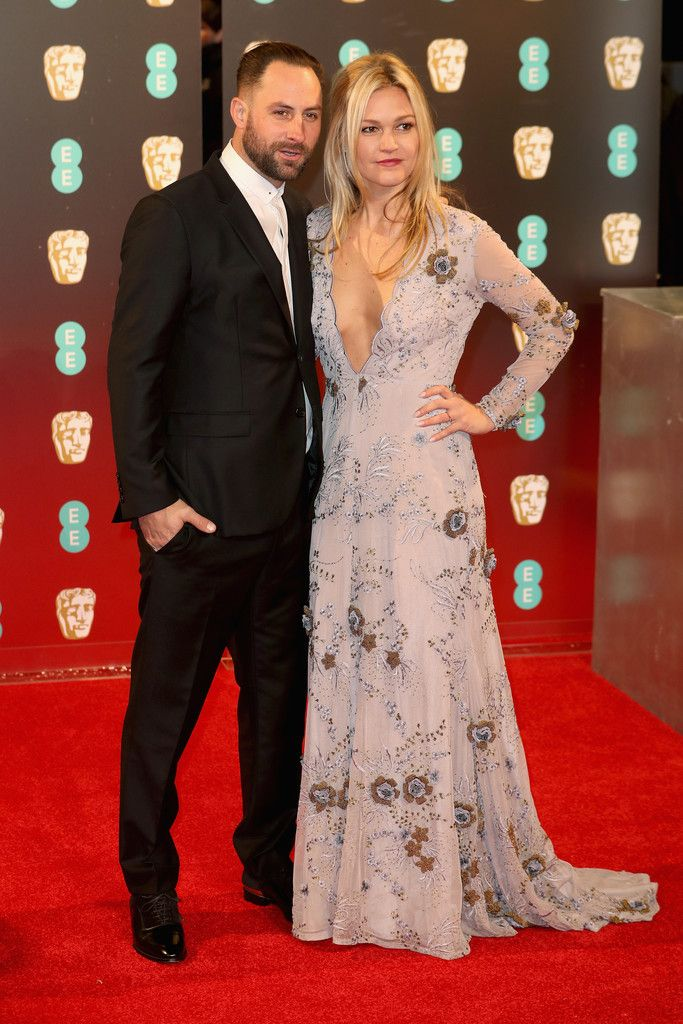 Julia Stiles Photos Photos - Preston J.Cook and Julia Stiles attend the 70th EE British Academy Film Awards (BAFTA) at Royal Albert Hall on February 12, 2017 in London, England. - EE British Academy Film Awards - Red Carpet Arrivals