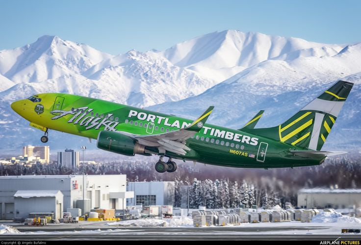 Alaska Airlines Boeing 737-790 N607AS departing Anchorage-Ted Stevens, February 2014. Alaska Airlines is the jersey sponsor of the Portland Timbers who play in the MLS. (Photo: Angelo Bufalino)