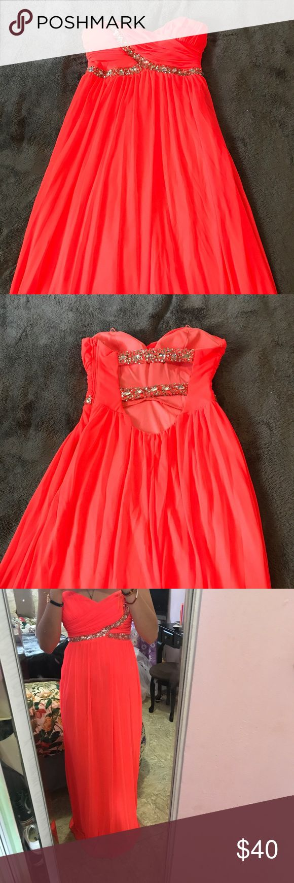Neon orange prom dress Beautiful neon prom dress only worn once. In almost perfect condition except for the bottom that shows signs of wear (not noticeable at all when on). City Studio Dresses Prom