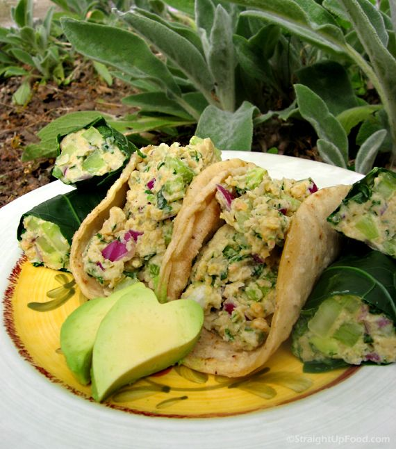 TU-NO SALAD WRAPS 2 cans chickpeas/garbanzo beans  4 ribs celery  ½ red onion  2 tablespoons chopped fresh basil (or other fresh herb)  ¼ cup chopped curly or Italian parsley  1 avocado (optional)  1 bunch collard greens  1 package corn tortillas  DRESSING  ½ cup raw, plain cashews (or other nut) soaked in ½ cup water  3 tablespoons lemon juice  2 teaspoons apple cider or rice vinegar  1 tablespoon prepared/wet mustard  ½ teaspoon garlic powder  1-2 teaspoons kelp powder