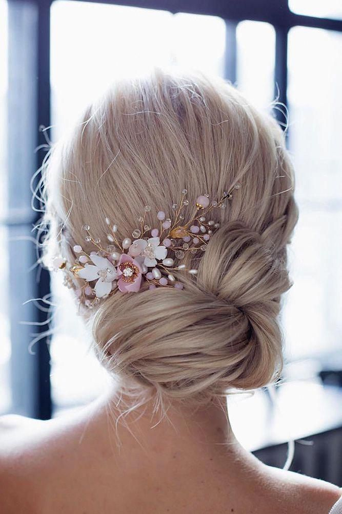 bridal hair accessories to inspire hairstyle low updo with white and pink flowers annamelostnaya via instagram #makeupaccessories