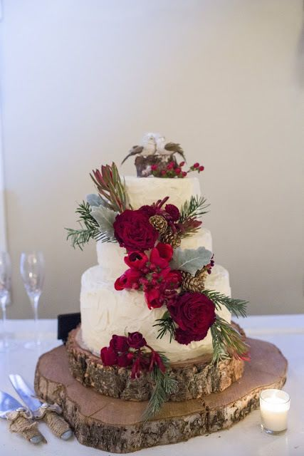 Red and White Wedding Cake: This lovely, woodsy wedding cake hits the nail on the head if you're thinking of a wintry red wedding. The dark red roses, pine cones, and spruce branches look wild but romantic. Very Beauty & the Beast, right? | Gorgeous Ideas for a Red Wedding Palette
