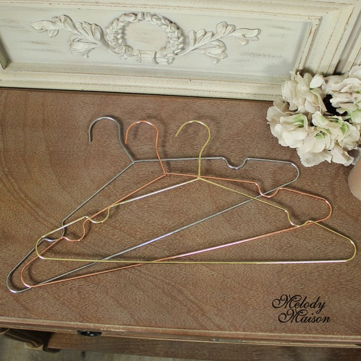 Set of Three Metal Coat Hangers A set of stylish metal coat hangers Made from metal in colours of silver, gold and copper Hang your clothes in style Great gift idea for the fashion conscious