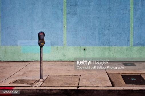 Stock Photo : Parking meter with blue wall