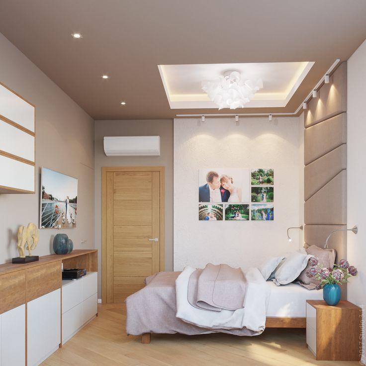 Стена в изголовье покрыта мягкими панелями. Потолочная ниша дает комнате дополнительный объем.